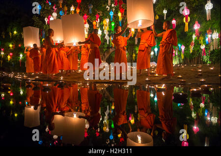 CHIANG MAI, THAILAND - NOVEMBER 07, 2014: Groups of Buddhist monks launch sky lanterns at the Yee Peng festival - Stock Photo