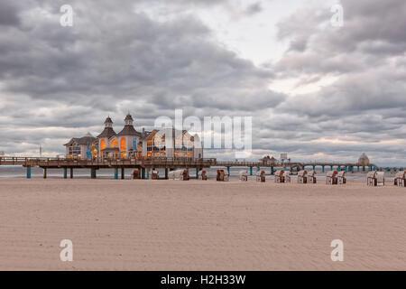 Beach and historic pier at Ostseebad Sellin, Ruegen, Germany, at dusk - Stock Photo