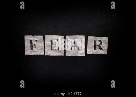Word Fear on a blackboard. Close up. - Stock Photo