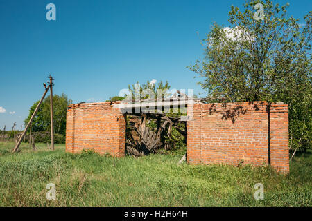 The Ruined Brick Building In The Exclusion Rural Area After Chernobyl Catastrophe. The Consequences Of The Nuclear - Stock Photo