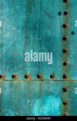 Oxidized copper plate surface texture, abstract corroded metal background - Stock Photo