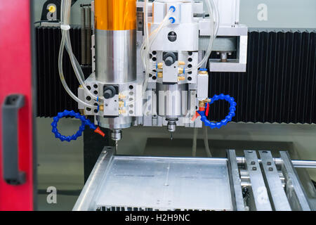 Robotic arm at production line in factory - Stock Photo