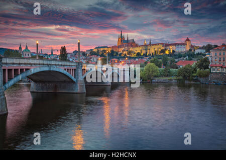 Prague at Sunset. Image of Prague, capital city of Czech Republic and Charles Bridge, during sunset. - Stock Photo