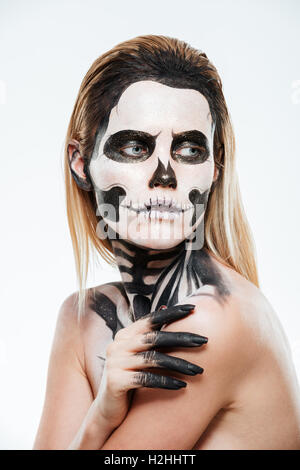 portrait of young woman with gothic halloween makeup over white background stock photo