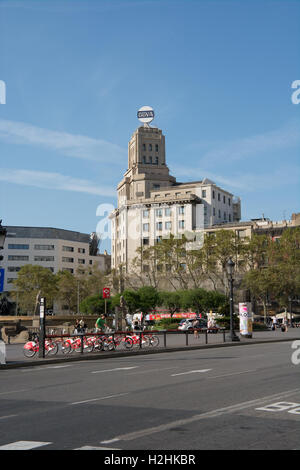 a view across Plaça de Catalunya Barcelona with a bicycle hire rack in the foreground - Stock Photo
