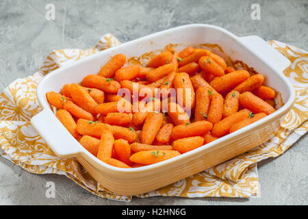 Honey Glazed Baby Carrots With Thyme and Nuts - Stock Photo