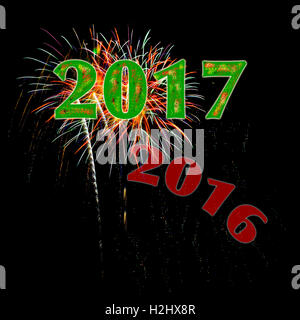 Year 2017 numbers with 2016 fading away fireworks on black background for New Year's Day or New Year's Eve concept - Stock Photo
