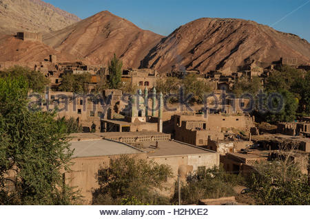 Uighur village of Tuyoq near Turpan by the Flaming Mountains in Xinjiang Province, China - Stock Photo
