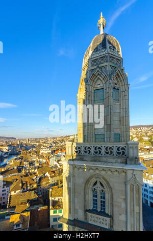 View of the Old Town (Altstadt) and the tower of the Grossmunster (great minster) Church. In Zurich, Switzerland - Stock Photo