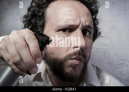 businessman with a spray, cleaning, man in white shirt with funn - Stock Photo