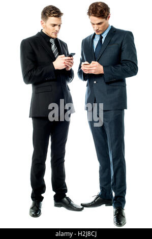 Two businessmen using the phone - Stock Photo