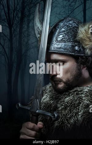 Peace, Viking warrior, male dressed in Barbarian style with swor - Stock Photo