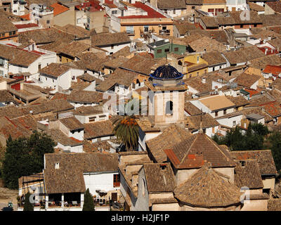 panoramic view over tiled rooftops and indigo blue church dome from wall of castle at Xativa Spain Espana - Stock Photo