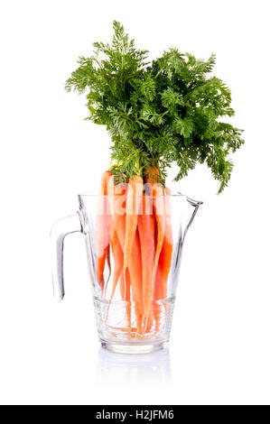 Carrot vegetable juice in glass jug isolated on white background cutout - Stock Photo