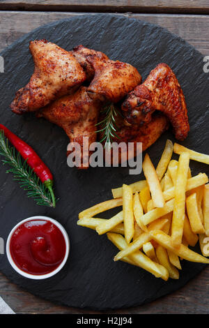 Fried roasted chicken wings french fries and sauce - Stock Photo