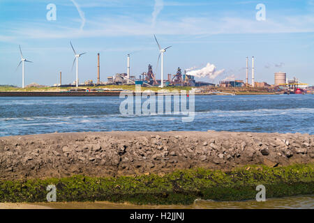 Steel making industry and North Sea Canal in IJmuiden near Amsterdam, Netherlands - Stock Photo