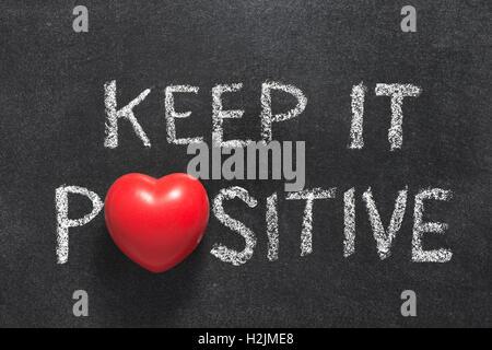 Positive Attitude Phrase Handwritten On Blackboard With Heart Symbol
