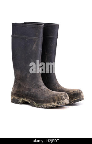 Dry dirty Mud boots isolated on pure white background 3/4 view - Stock Photo