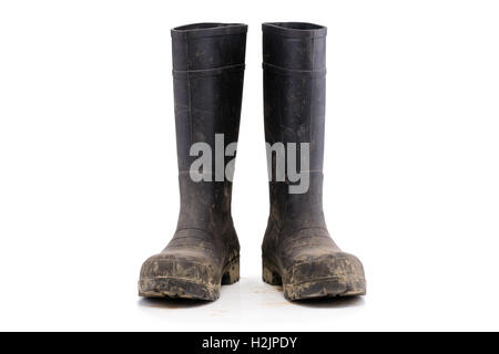 Dry dirty Mud boots isolated on white background front view - Stock Photo