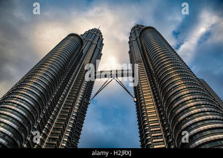 Powerful upward view of the Sky bridge and Observation Deck connecting the Petronas Twin Towers in Kuala Lumpur, Malaysia.