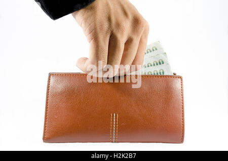 hand with black suit pick bill in wallet on isolated - Stock Photo