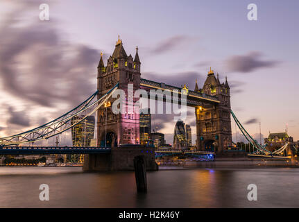 Lights and boats captured at sunset around Tower Bridge, London, UK - Stock Photo