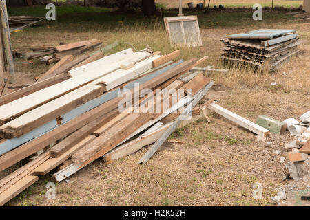 Stacks of timber and iron from house renovation, construction site - Stock Photo