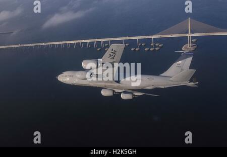A U.S. Air Force KC-135R Stratotanker aircraft flies above the Bob Graham Sunshine Skyway Bridge over Tampa Bay - Stock Photo