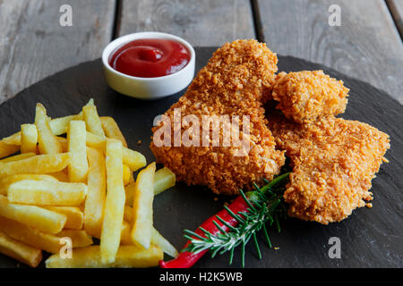 Breaded crispy chicken wing fried french fries sauce - Stock Photo