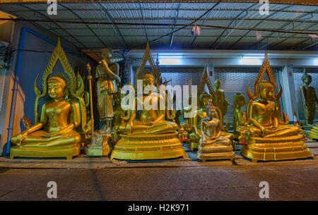 Street of Buddha statues in Bangkok, Thailand - Stock Photo