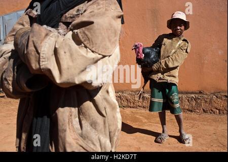 Betsileo boy holding a turkey ( Madagascar)