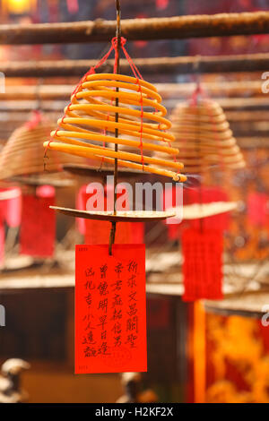 Burning incense coils in the Man Mo Temple in Hong Kong, The temle was build in 1847-1862 by Chinese merchants - Stock Photo