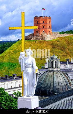 View over the Dome of Cathedral and Saint Helena statue holding the Cross to Gediminas Tower on the hill, Vilnius, - Stock Photo