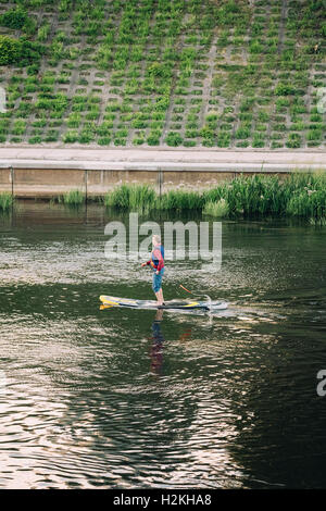 Vilnius, Lithuania - July 08, 2016: Young Man Practice Stand Up Paddling SUP Or Standup Paddle Boarding On Neris - Stock Photo