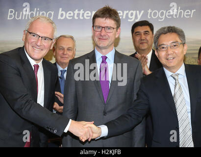 (left to right) Jean-Bernard Levy chairman of EDF Group, French Foreign Minister Jean-Marc Ayrault, Greg Clark Secretary - Stock Photo