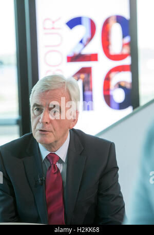 Shadow Chancellor of the Exchequer,John McDonnell,gives a television interview at the Labour Party conference in - Stock Photo