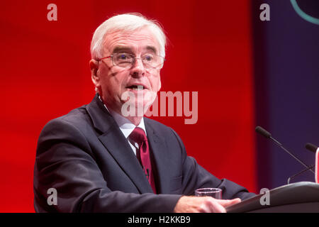 Shadow Chancellor of the Exchequer,John McDonnell,addresses the Labour Party conference in Liverpool - Stock Photo