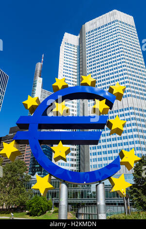 The Euro symbol in front of the Eurotower, Willy-Brandt-Platz, Financial District, Frankfurt, Hesse, Germany - Stock Photo