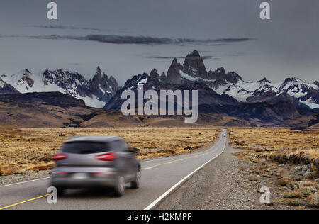 Blurred car traveling on the road to Los Glaciares National Park, Patagonia, Argentina - Stock Photo