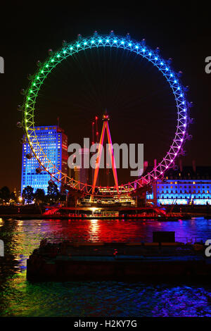 London, UK. 29th September 2016. The London Eye was illuminated in colourful Rainbow colours for to promote the - Stock Photo