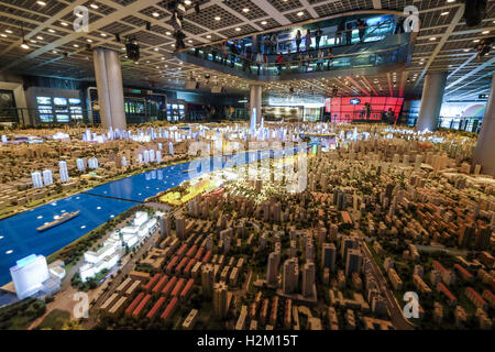 Los Angeles, California, USA. 5th Sep, 2016. Visitors look at a scale model of the center area of town at the Shanghai - Stock Photo