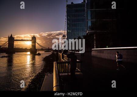 London, UK. 30th September, 2016. UK Weather: Sunrise over Tower Bridge in central London Credit:  Guy Corbishley/Alamy - Stock Photo
