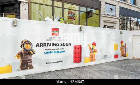 London, UK.  30 September 2016.  As construction continues, humorous hoardings advertise the new flagship store - Stock Photo