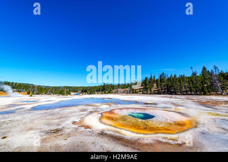 Wide angle view of Chromatic Pool in Yellowstone National Park - Stock Photo