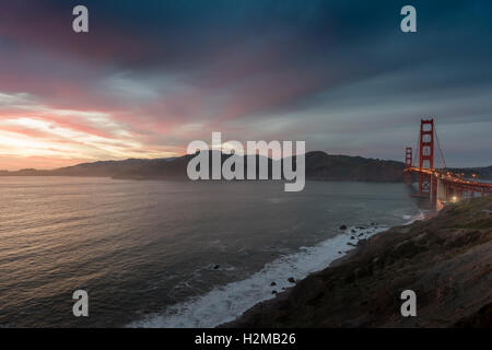 Sunset over the Californian coast showing the Golden Gate Bridge crossing the entrance to San Francisco Bay. USA. - Stock Photo