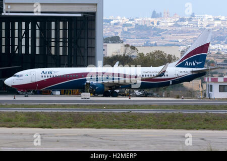 Arik Air (of Nigeria) Boeing 737-76N [5N-MJQ] being serviced at Lufthansa Technik Malta, with the no.1 engine removed. - Stock Photo