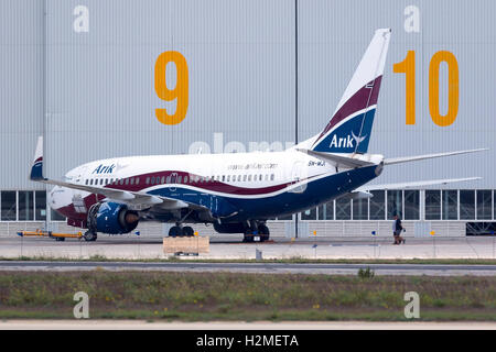 Arik Air (of Nigeria) Boeing 737-76N [5N-MJI] being serviced at Lufthansa Technik Malta, with the no.1 engine removed. - Stock Photo