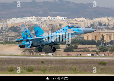 Ukrainian Air Force Sukhoi Su-27UB departing after the airshow is over. - Stock Photo