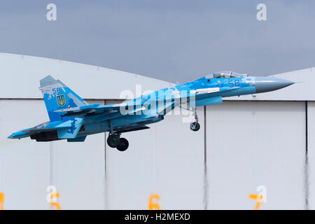 Ukrainian Air Force Sukhoi Su-27 departing after the airshow is over. - Stock Photo