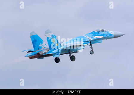 Two Ukrainian Air Force Sukhoi Su-27'departing together after the airshow is over. - Stock Photo